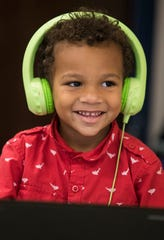 Nehemiah Ashley, 4, plays an educational video game Wednesday, Dec. 4, 2019, in a preschool class at James Stephens International Academy. Although district-run pre-Ks will move to remote learning with other Lee County public schools, privately run daycare and preschool facilities are being told the decision to close is up to them.