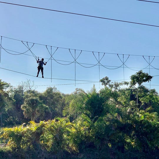 The new ropes course at Gator Mike's features three zip lines, swinging platforms suspended from ropes, a balance beam, tightropes and more.