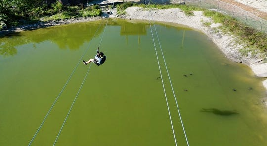 Gator Mike's new 550-foot zip line takes you over the park's pond filled with fish and turtles. The zip line can reach speeds of 26 miles per hour.