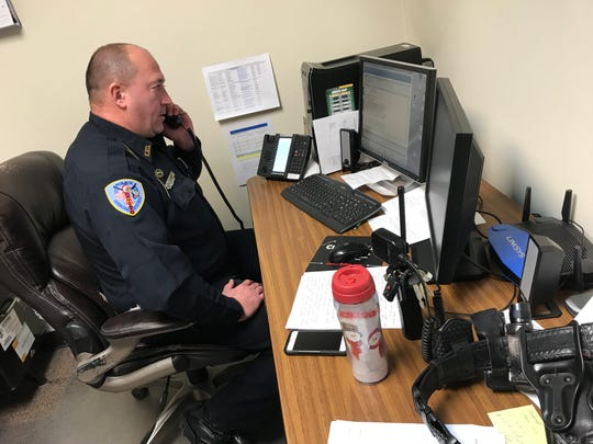 James Kleiman Jr. takes a call at the Kewaunee Police Department. Kleiman will become the department's police chief Jan. 3.