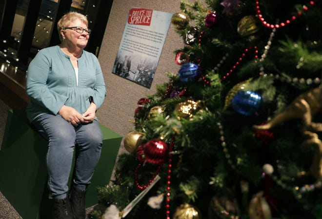 Pat Jansen of De Pere gazes at Bruce the Spruce at the Neville Public Museum of Brown County. Let's call it Christmas magic, but she also knows a little something about what it's like to be inside the 9-foot talking tree looking out.