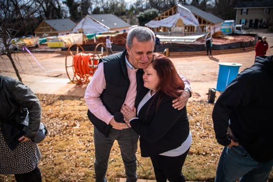 Geri Patterson embraces Dr. Jim Dant, of the First Baptist Church of Greenville at a dedication ceremony Wednesday, December 11, 2019, for Geri Patterson and her family who will be moving into their Habitat for Humanity home in Greenville's Sterling community in February.