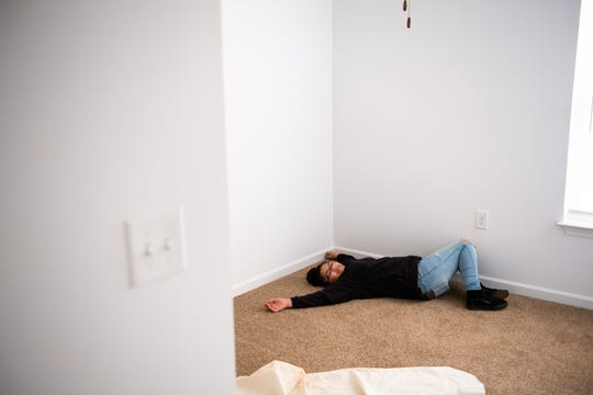 Aviana Patterson, 11, lies on the floor of one of the rooms of her new Habitat for Humanity home in Greenville's Sterling neighborhood after a dedication ceremony Wednesday, December 11, 2019, for the home she, her mother Geri Patterson and her sisters will be moving into in February.