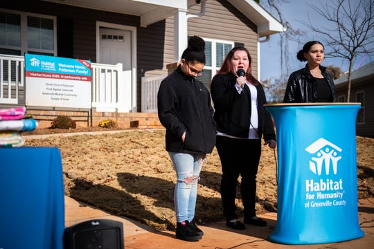 Geri Patterson, accompanied by two of her children, Aviana, 11, and Genesis, 13, speaks at a dedication ceremony Wednesday, December 11, 2019, for the Habitat for Humanity home she and her family will be moving into in Greenville's Sterling community in February.