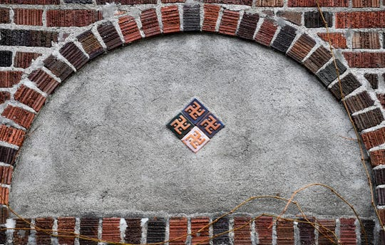 Four tiles with swastika-like designs on the facade of Corbin Hall at the University of Montana in Missoula, Montana are shown in this photo from Dec. 6, 2019. The tiles are at the center of a discussion by University of Montana students and faculty to have them removed. (Tom Bauer/The Missoulian via AP)