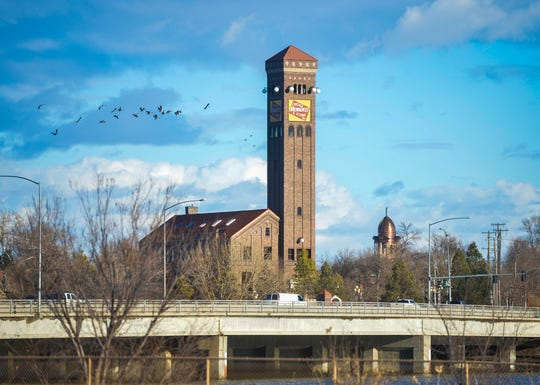 Milwaukee Depot building and the copper dome of the Cascade County Courthouse seen from the west bank of the Missouri River in Great Falls, Dec. 11. Not much snow will be flying before Christmas, which likely will be brown.
