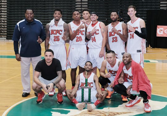 The KFC Bombers, with coach Gerrard Barnes at left, defeated Team Gatorade 110-98 to win the Triton Men's Basketball League title Dec. 11 at the UOG Calvo Field House.