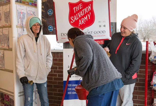 Salvation Army volunteers Amy Riggs, lefts, and Tamara Clark, right, collect donations in the entrance of Sureway off South Green Street Tuesday afternoon.