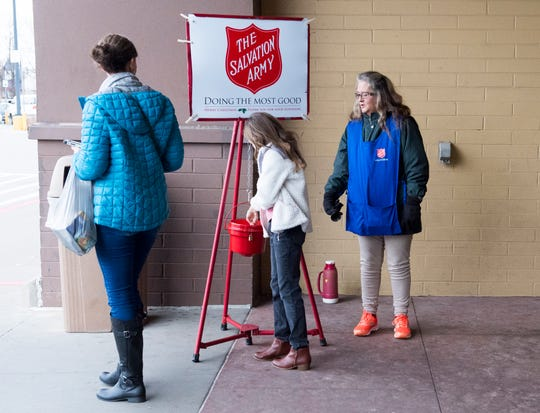 Salvation Army volunteer Sherri Mclean, right, thanks Rylee Doster, 9, for her donation outside Walmart in Henderson Tuesday afternoon.