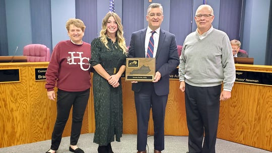 "Kentucky League of Cities' Bryanna L. Carroll (second from left), Henderson Mayor Steve Austin (right) and Henderson Commissioner Patti Bugg (left) present state Senator Robby Mills with a 2019 ""Friend of Kentucky Cities"" award at the Tuesday Henderson City Commission meeting."