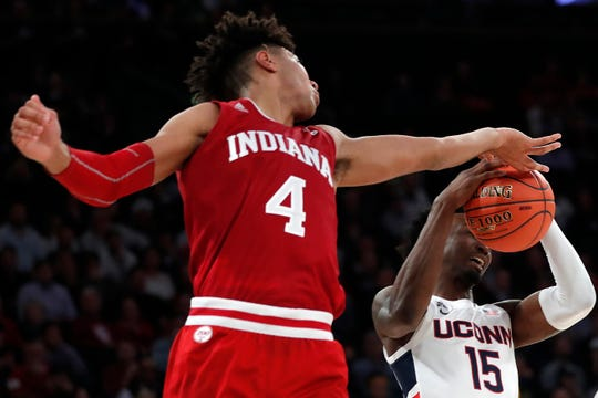 Indiana forward Trayce Jackson-Davis (4) defends Connecticut forward Sidney Wilson (15) during the second half of an NCAA college basketball game in the Jimmy V Classic, Tuesday, Dec. 10, 2019, in New York. Indiana defeated UConn 57-54. (AP Photo/Kathy Willens)