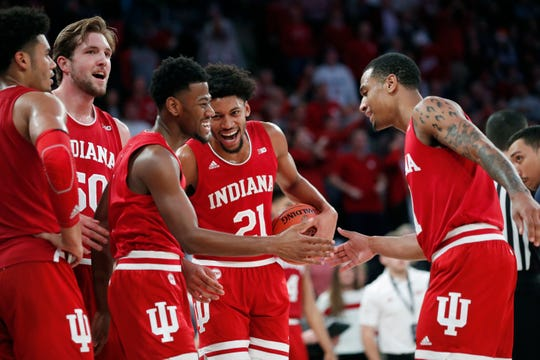 Teammates celebrate with Indiana guard Al Durham, third from left, after he was the victim of a flagrant foul during the second half of an NCAA college basketball game against Connecticut in the Jimmy V Classic, Tuesday, Dec. 10, 2019, in New York. Indiana defeated UConn 57-54. (AP Photo/Kathy Willens)