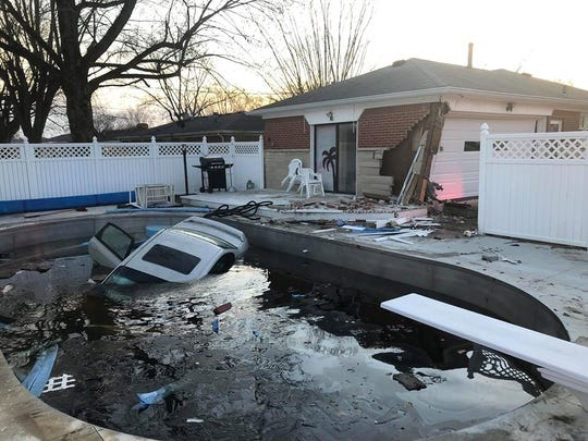 Police and fire officials are investigating after a crash ended with a car submerged in a Plainfield pool.