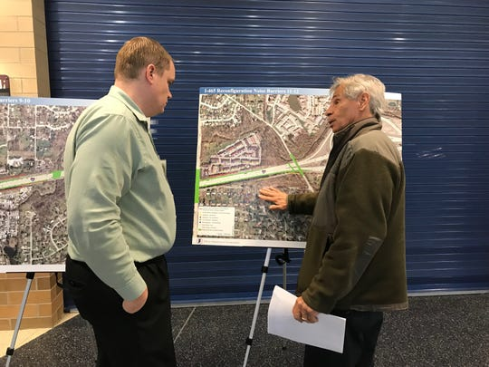 Indianapolis resident Matthew Iaria (right), is concerned that a noise barrier won't be built between his house and I-465, adding to the growing noise problem in his neighborhood.