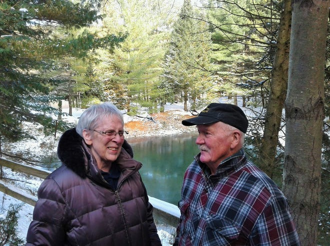 Ruth and Don Myers of rural Solon enjoy this spectacular winter scene just beyond their front step. Don has developed a conservation-minded acreage by planting some 40,000 conifers surrounding six ponds.