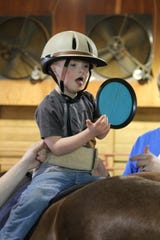 Hippotherapy via horseback riding at Rein-Bow Riding Academy can help children with disabilities develop muscles they don't normally use.