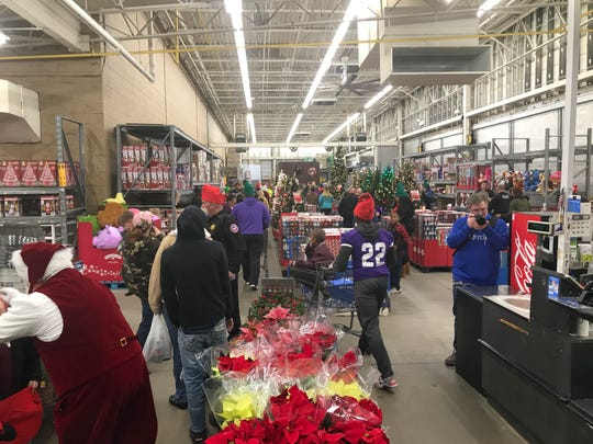 Santa Claus and a few football players from Milan High School were on hand for 2019 Shop with a Cop on Tuesday night at the Wal-Mart in Milan.