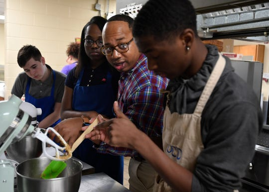 Haywood High School Culinary Instructor Tim Hayes talks to students as they mix gingerbread dough on Tuesday, Dec. 10, 2019. Hayes was also a contestant on the Netflix series Sugar Rush.