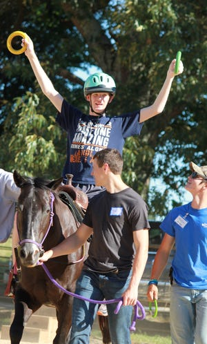 Children with disabilities can gain new experiences and developmental benefits through horseback riding at Rein-Bow Riding Academy.
