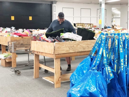 """""""We are typically busy and the shopping carts get grabbed quickly so we have the IKEA bags for customers to use in store,"""" said Lindsey Wilson, owner of Bin Barn."""