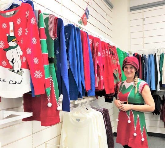 """Lindsey Wilson opened Bin Barn on Chapman Highway in November. """"We have a rack of holiday sweaters and they are only $5 each; all week I've been wearing a different one to model them,"""" she laughed."""