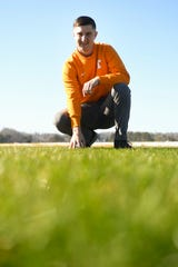 University of Tennessee senior Conlan Burbrink poses for a photo at UT's Institute for Agriculture Wednesday, Dec. 11, 2019. Burbrink has been selected out of a national competition to help prep the turf before the Super Bowl.