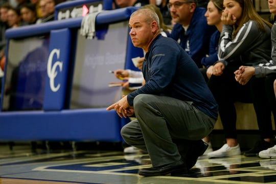 Central Catholic's Craig Devault watches from the sidelines during the first quarter of an IHSAA girl's basketball game, Tuesday, Dec. 10, 2019 in Lafayette.