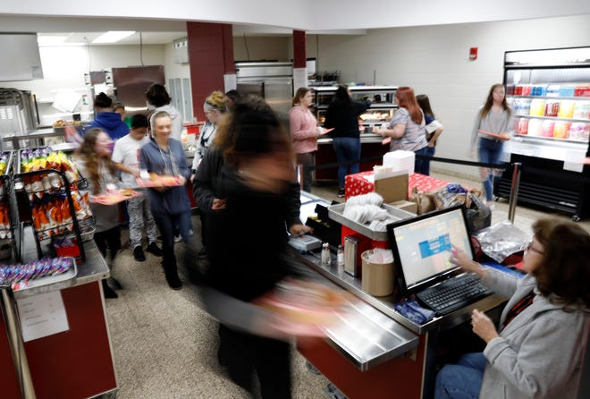 Fairfield Union High School students go through the school's lunch line Wednesday morning, Dec. 11, 2019, in Rushville. Donors have paid off student lunch debt at five school districts throughout the county.