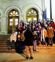 A youth choir performs outside of First United Methodist Church in 2006 during the Fairfield County Heritage Association Candlelight Tour. The 41st tour is happening Saturday.