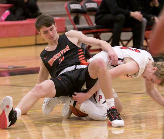 Brighton's Owen Ehman and Pinckney's Kevin McCoy battle on the floor for a loose ball on Tuesday, Dec. 10, 1019.