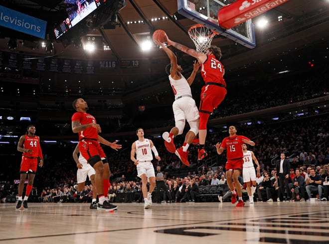 Texas Tech's Avery Benson (24) blocks a shot by Louisville's Lamarr Kimble (0) during the first half of the Jimmy V Classic game Dec. 10, 2019 at Madison Square Garden In New York.