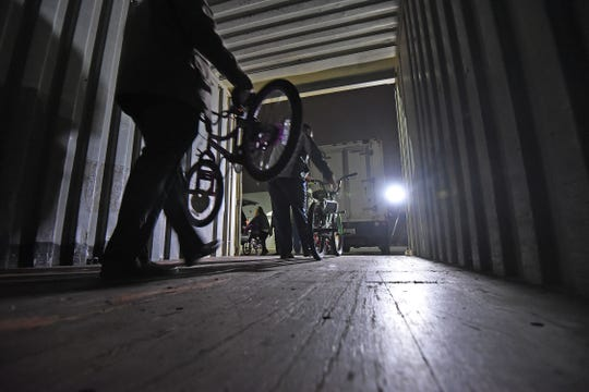 Volunteers loaded bikes from Walmart on a truck for delivery to Crossroads Church on Tuesday evening.