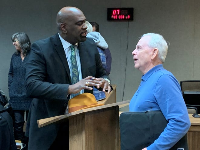 Bishop Greg Draper, left, pastor of Mt. Zion Missionary Baptist Church, talks with Dan Neidig, at-large member of the City of Marion Board of Zoning Appeals, following Tuesday's board meeting. The BZA approved variances Draper and fellow pastor Bishop Corredon Rogers requested related to a workforce housing pilot project. The pastors hope to have the houses built in the spring of 2020.