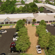 Planning Board approved unanimously on Dec. 6, 2019 amendments to the site development plan of Marco Town Center, including changes to landscaping and parking. In the image, the new conceptual architectural rendering substitutes asphalt with pavers at one of the mall's entrances.