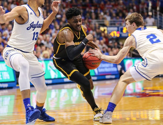 Kansas guard Christian Braun tries to strip the ball from UW-Milwaukee  guard Darius Roy Tuesday night. Roy finished with 25 points.