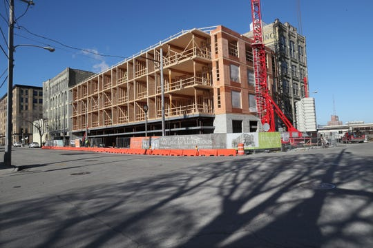 Timber Lofts, Milwaukees first mass timber building, is under construction at 300 W. Florida St. The apartment project combines a former industrial building (right) with a new addition that uses high-grade timber instead of steel for its frame.