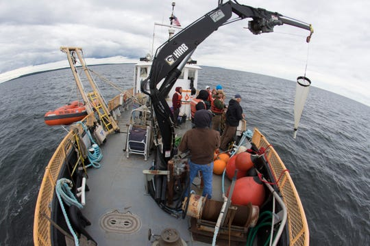 Students aboard the Neeskay, a UW-Milwaukee research vessel, learn how to take measurements in Green Bay west of Sturgeon Bay. The trip was primarily for a graduate class. Student researchers were gathering data on bay ecology. (Photo: Mark Hoffman / Milwaukee Journal Sentinel)