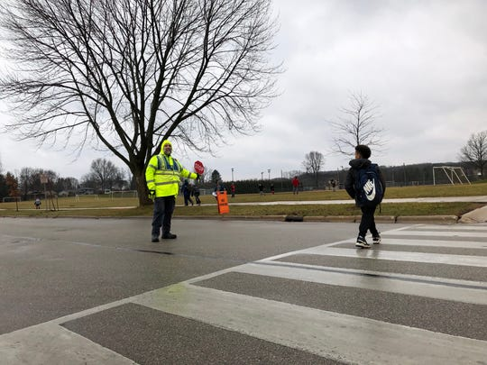 Charles Betka has been the crossing guard near Thomas Jefferson Middle School in Port Washington since 2007.