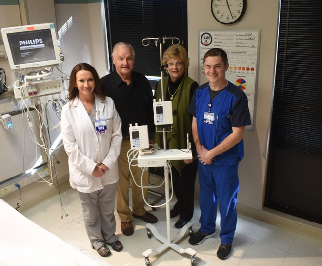 The IV pumps used at Baxter Regional Medical Center will be getting an upgrade next year thanks to a donation from Frank and Janice Fletcher. Standing next to one of the hospital's smart pumps is (from left) BRMC Chief Nursing Officer Shannon Nachtigal, Clark Fletcher, Janice Fletcher and ICU RN Tanner Brannon.