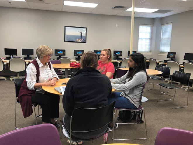 Karen Heslep (left), dean of Arkansas State University-Mountain Home's School of Business & Technology, talks to potential students Hannah Stewart (in black), Sherri Powell and Riya Patel about a new course that will be offered in the spring semester. The newly revamped Ready2Work curriculum will be offered in a course will be required of most of the Business, Computer Information Systems, and Technical Center programs.