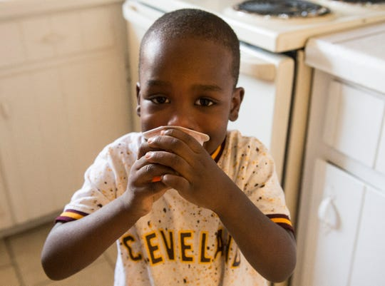"""Armani Goldsmith, 3, enjoys a snack at his home in Montgomery, Ala., on Wednesday, Dec. 11, 2019. Armani's mom Lakira """"Pigg"""" Goldsmith has been missing since Nov. 27, 2018."""