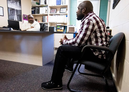 Gerald Jones, executive director of Brantwood Children's Home, talks with former resident Antavione Ferguson at the facility, in Montgomery, Ala., on Wednesday December 11, 2019.