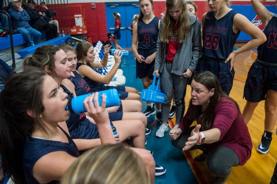 Lee-Scott coach Corye Ivatt talks with her team during a timeout at Macon East Academy in Cecil, Ala., on Tuesday, Dec. 10, 2019.