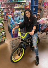 Jessica Meuse with some of the toys recently collected in Montgomery for the toy drive with Eastdale Mall and the Salvation Army.
