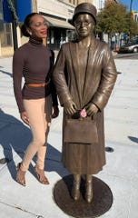 Kimberly Brown Pellum poses with the Rosa Parks statue in downtown Montgomery. Brown Pellum was the model for the statue's sculptor.