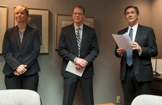 Left to right: Melissa Pease, Nathan Sloan and Dan Ridenour stand together for a press conference announcing Sloan as the Muncie Police Department's new chief and Pease as the deputy chief.