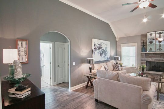 An arched doorway leads from the great room. A ceiling fan helps keep the area comfortable.