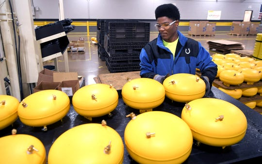 Liberty Technology Magnet High School senior Antwoin Williamson, 17, stocks the assembly line at the Stanley Black & Decker factory in Jackson, Tenn., on Nov. 21, 2019. Williamson is part of L.O.O.P., a unique work-based learning program in which high school students report to the factory instead of school.