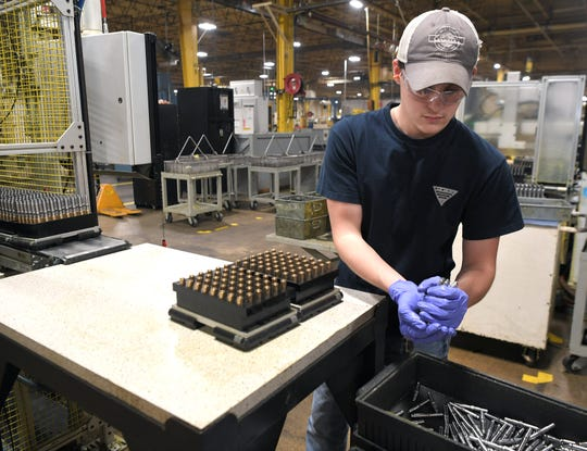 Liberty Technology Magnet High School senior Elijah Dyer, 17, works in the Stanley Black & Decker plant in Jackson, Tenn., on Nov. 21, 2019.  Jackson is home to LOOP, a unique work-based learning program in which high school students report to the factory instead of school.
