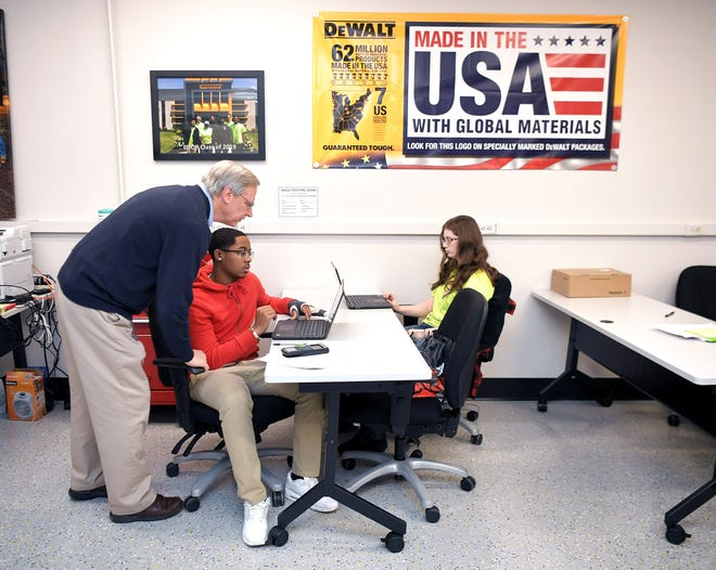 L.O.O.P. math teacher Bob Lay instructs high school students Bravian Mcgoughy and Savannah Simmons inside a classroom at the Stanley Black & Decker factory in Jackson, Tenn., on Nov. 21, 2019. L.O.O.P. is a unique work-based learning program in which high school students report to the factory instead of school.